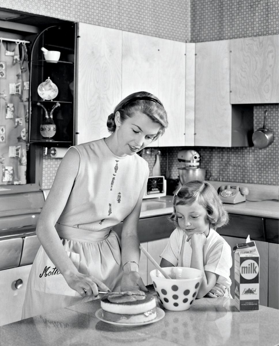 Mother and daughter making a cake, 1956
