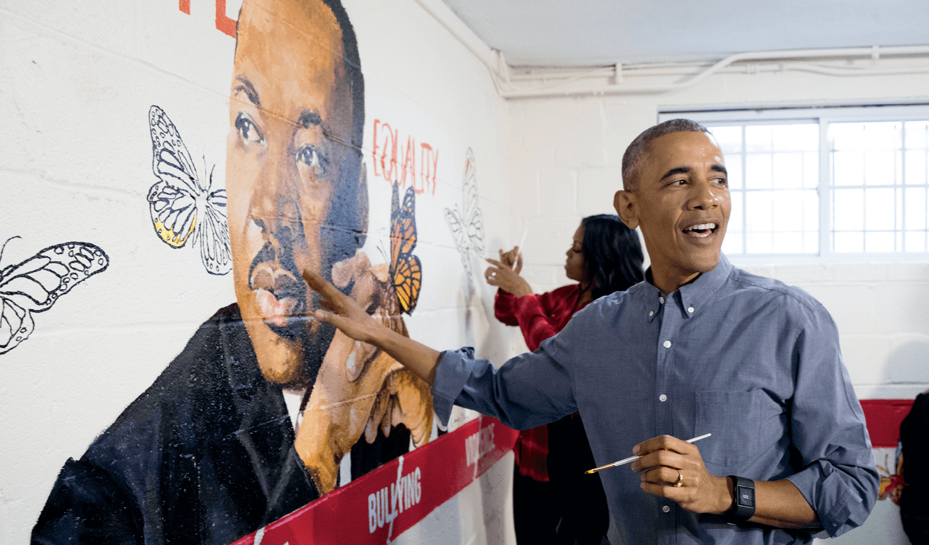 Barack Obama helps finish a mural on Martin Luther King Day, Washington DC, 2017