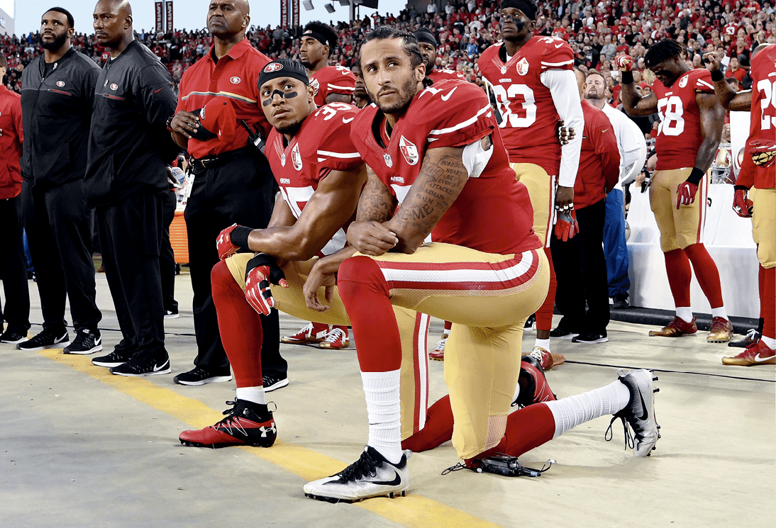 Eric Reid and Colin Kaepernick kneeling during the national anthem, 2016