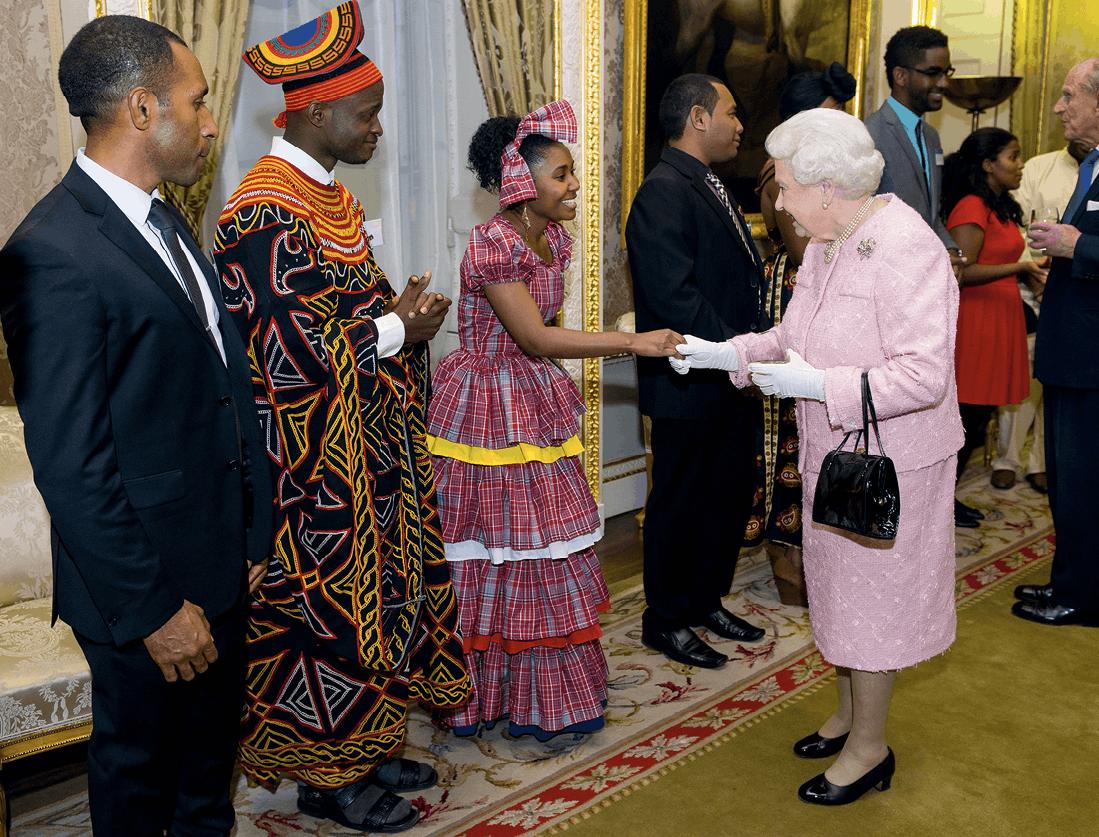Queen Elizabeth II meets Africa Regional Winner of the Commonwealth Youth Awards Achaleke Christian Leke and Caribbean Regional Winner Shamoy Hajare