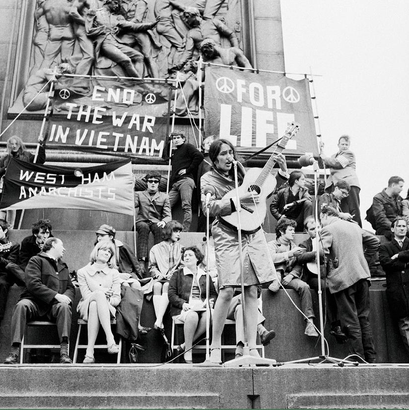 American folk singer Joan Baez performs at an anti- Vietnam War demonstration in London's Trafalgar Square, 1965