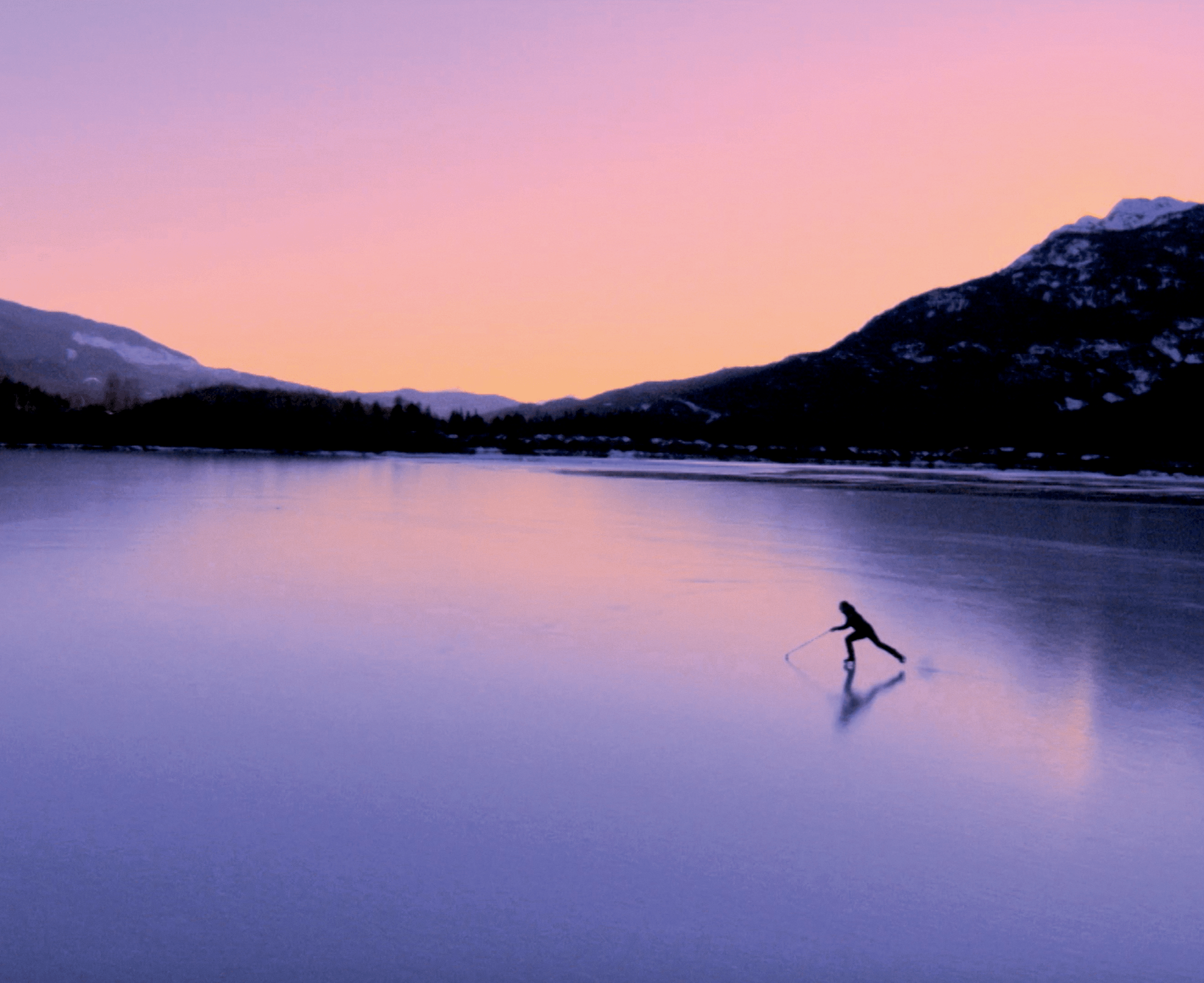 landscape - someone skating on a frozen lake