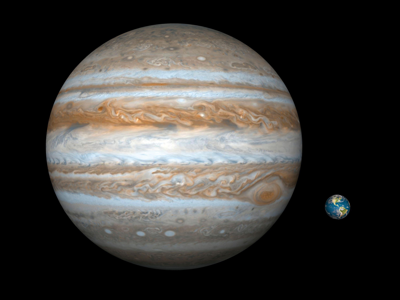 <stamp theme='svt-green1'>Doc. 1</stamp> Une illustration comparative de Jupiter (à gauche) et de la Terre (à droite).
