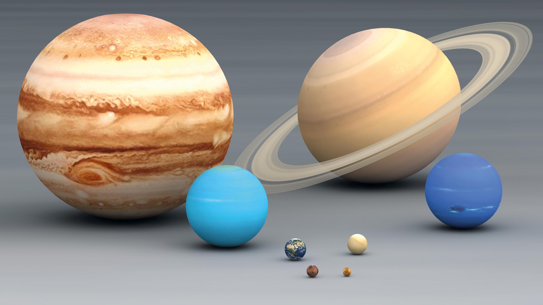 <stamp theme='svt-green1'>Doc. 1</stamp> Des maquettes des planètes du système solaire.