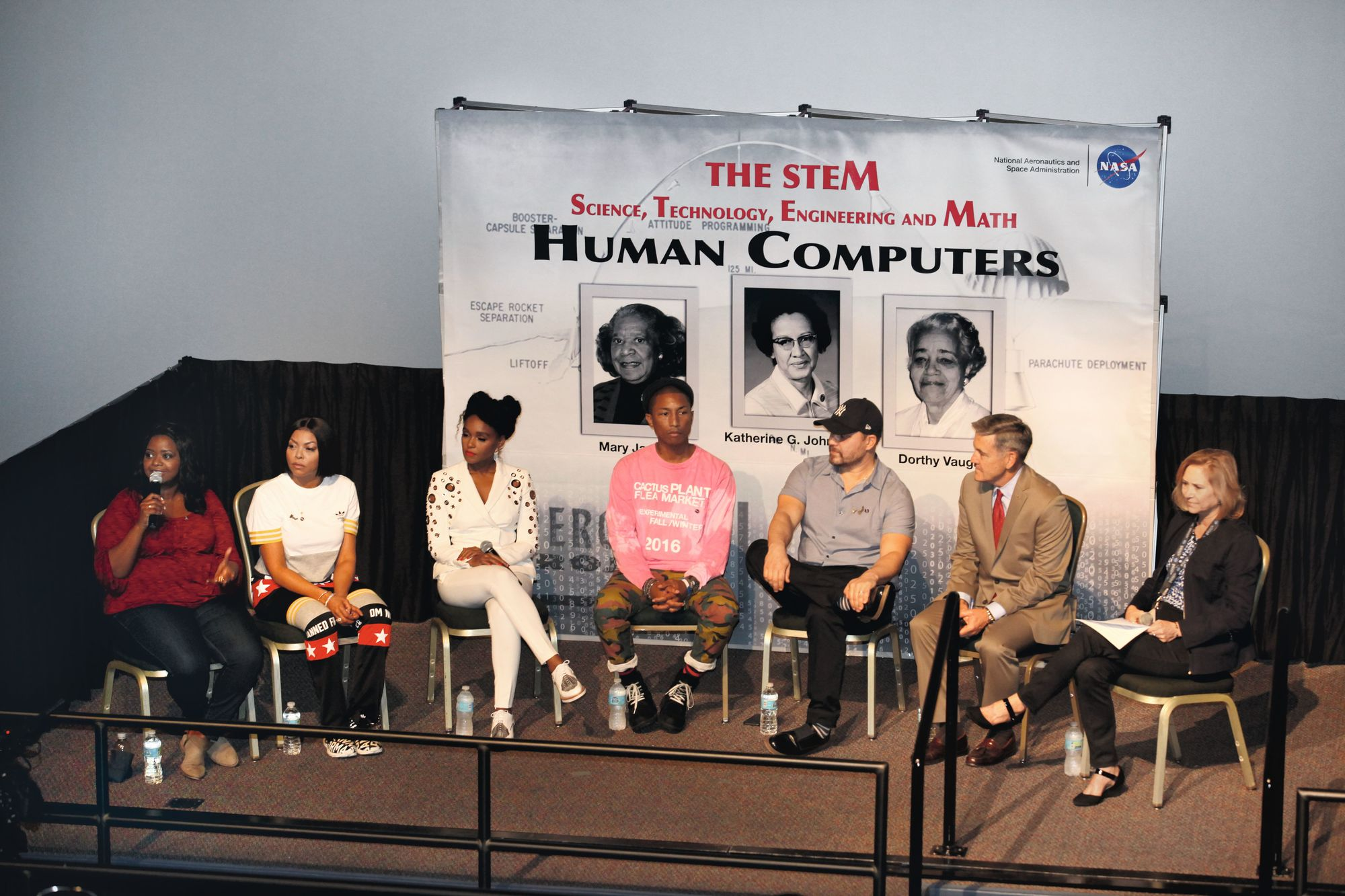 The cast and crew members of the movie Hidden Figures answer the audience's questions.
