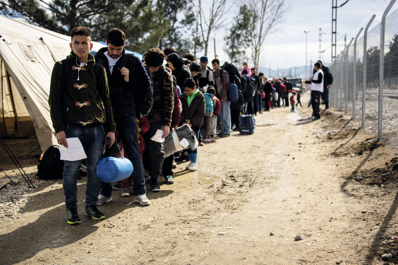 Demandeurs d'asile dans le camp d'Idomeni, à la frontière entre la Grèce et la Macédoine