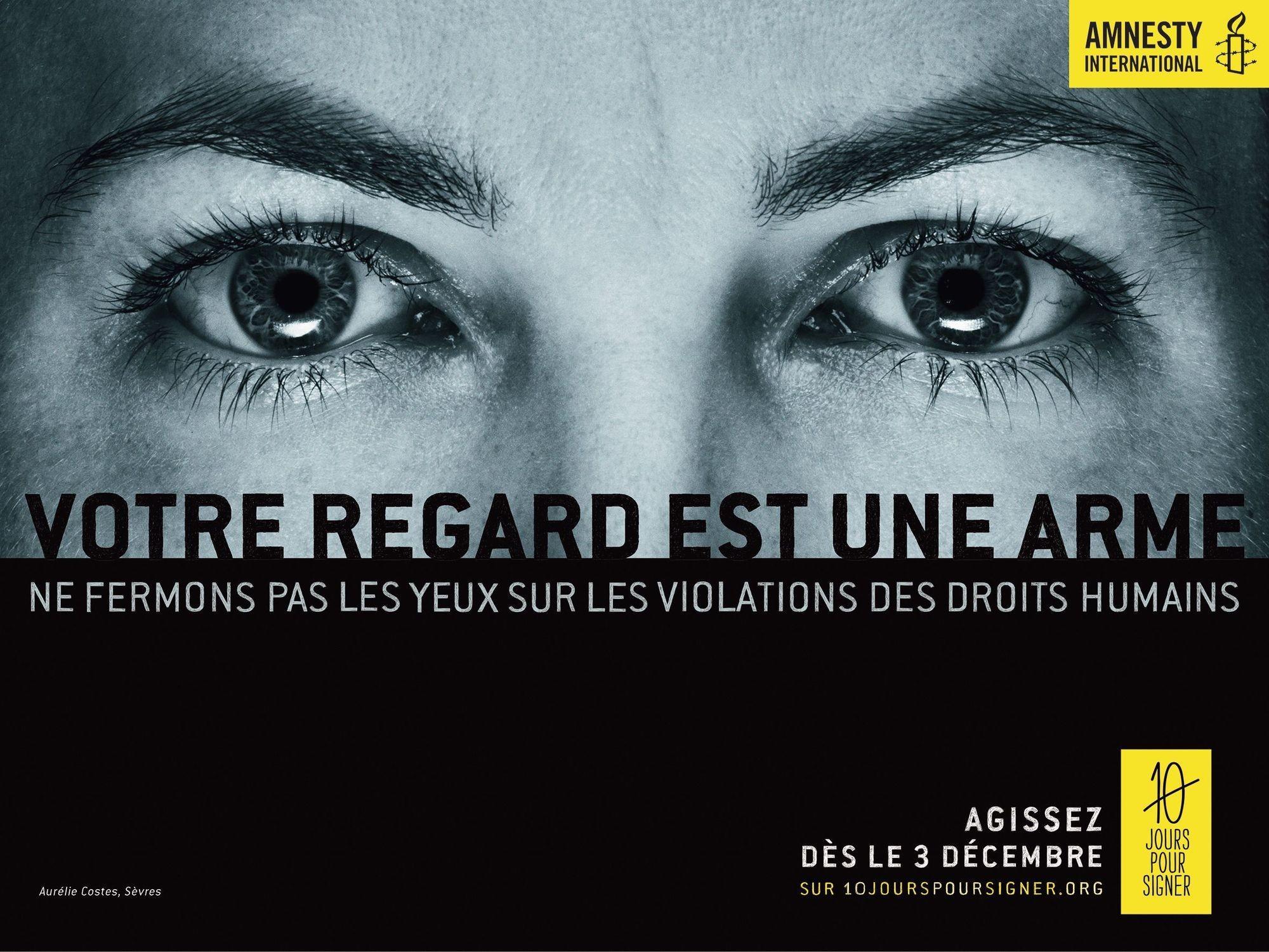 « Votre regard est une arme », affiche d'Amnesty International, 3 décembre 2014.