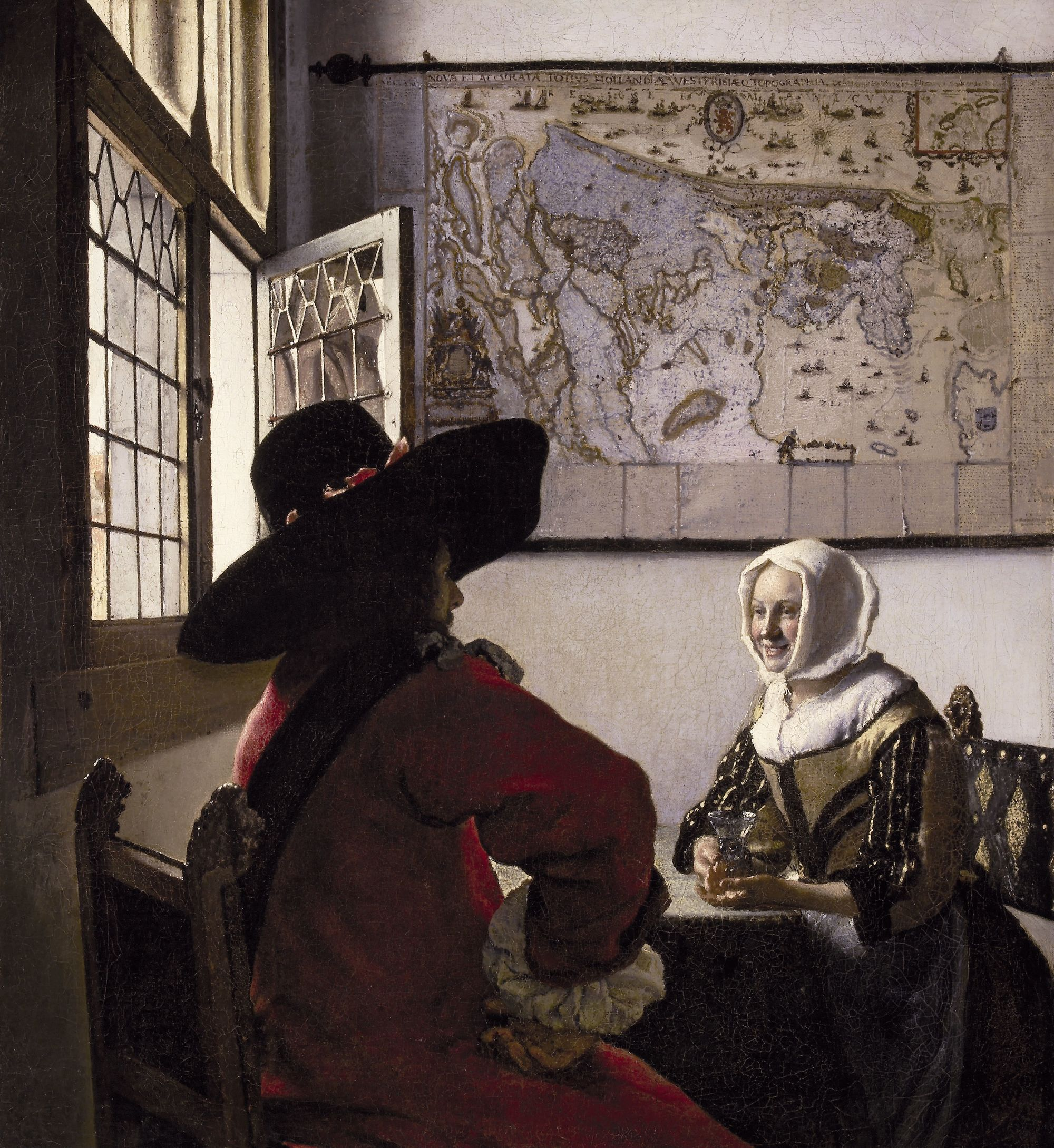 Soldat et jeune fille riant, Johannes Vermeer, vers 1657.